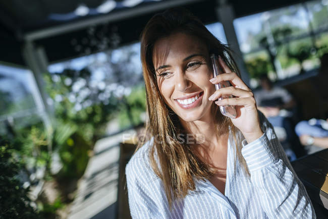 Smiling woman using phone — Stock Photo
