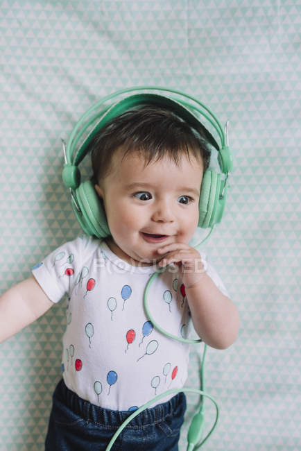 Baby girl with headphones — Stock Photo
