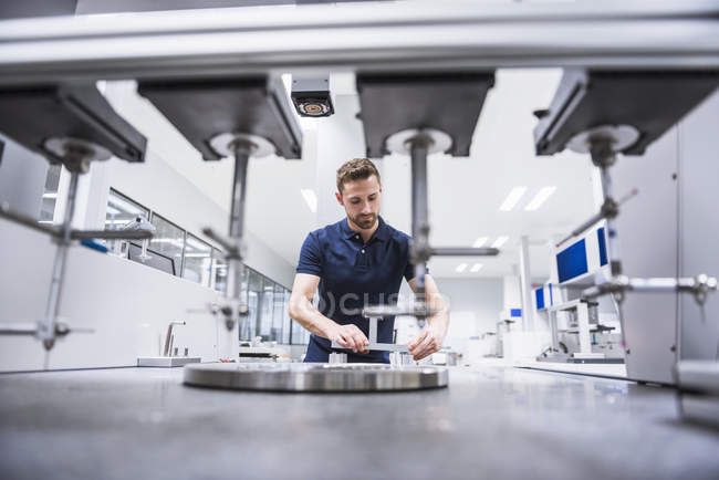 Man examining machine — Stock Photo