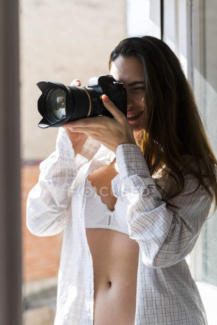 Woman taking picture with camera — Stock Photo