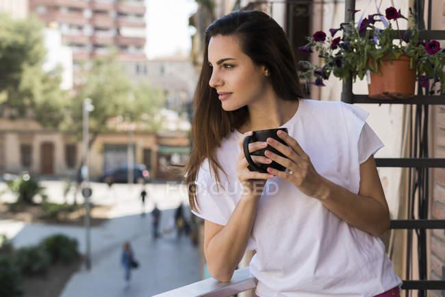 Woman with coffee mug — Stock Photo