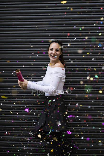 Woman throwing confetti — Stock Photo