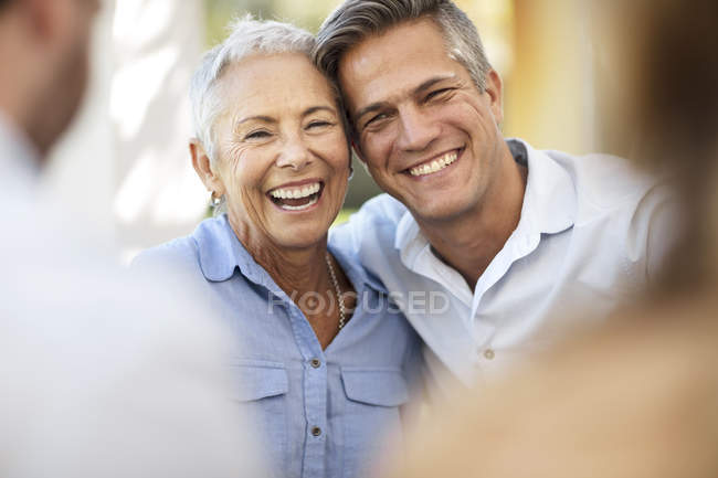 Happy senior woman with adult son outdoors — Stock Photo