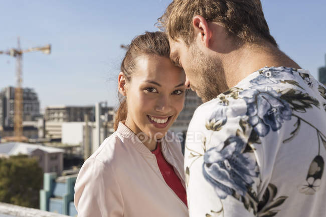Young couple on rooftop terrace — Stock Photo