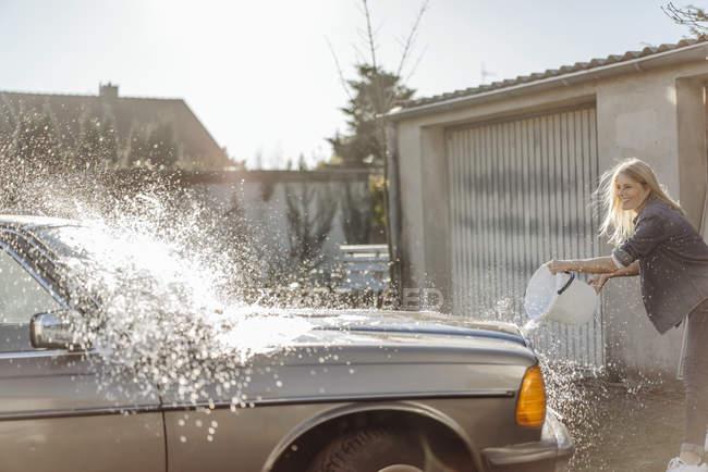 Woman washing car — Stock Photo