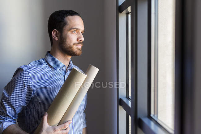 Architect looking out of window — Stock Photo