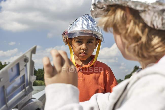 Boys with self made helmet — Stock Photo