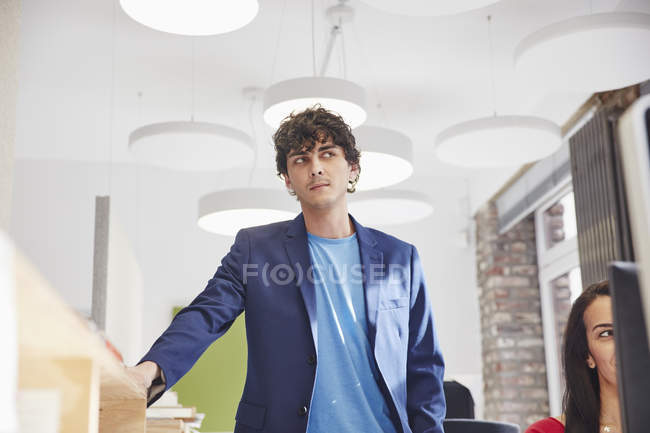 Man watching female colleague working — Stock Photo
