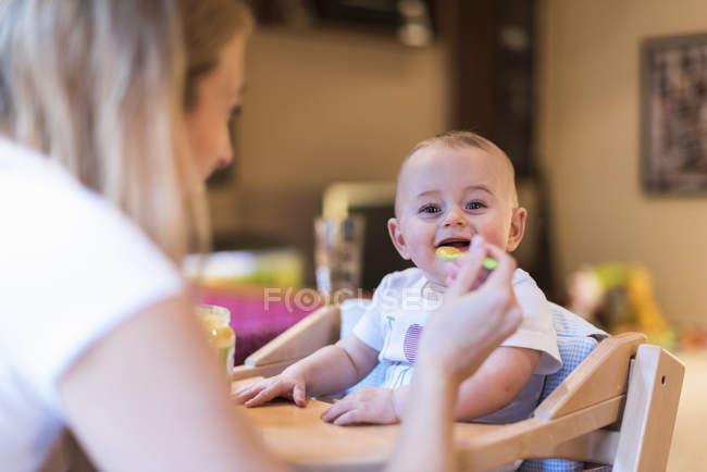 Mother feeding baby son — Stock Photo