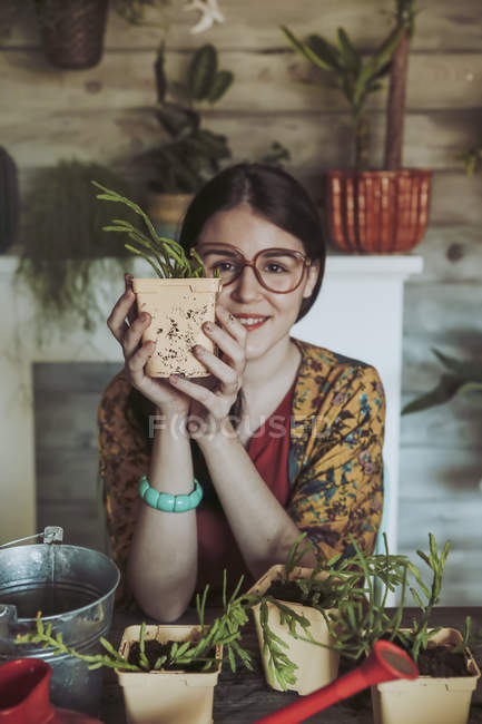 Woman holding freshly potted cactus — Stock Photo