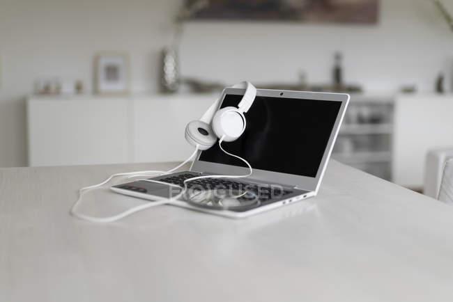 Laptop, headphones and CD — Stock Photo
