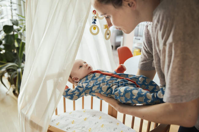 Mother putting her newborn baby — Stock Photo