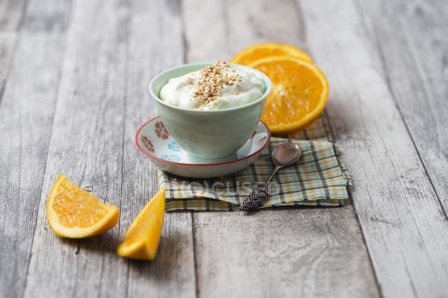 Cup with orange curd creme — Stock Photo
