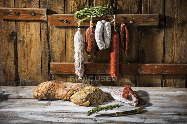 Salami and hard smoked sausages — Stock Photo
