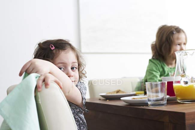 Little girls at breakfast table — Stock Photo