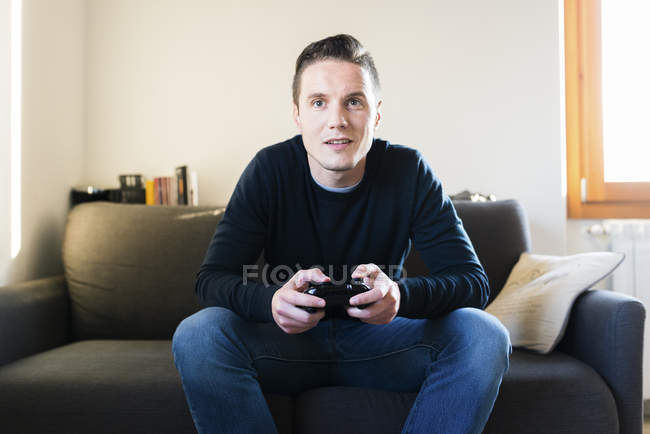 Man playing with games console — Stock Photo