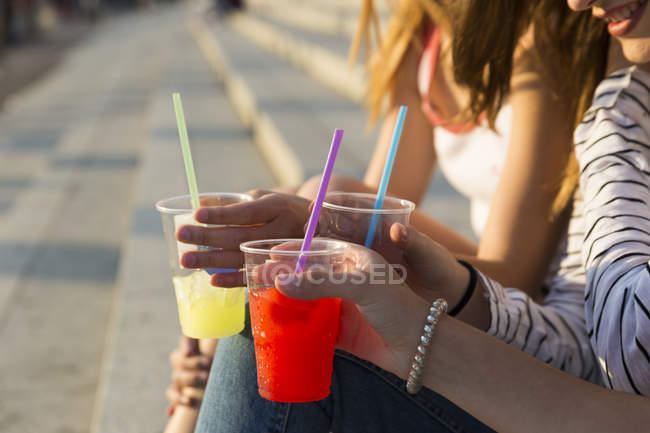 Young women with soft drinks — Stock Photo