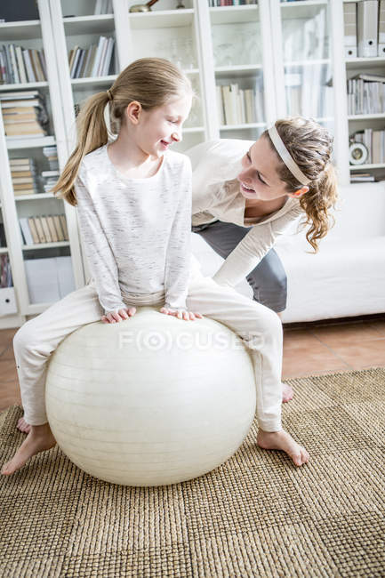 Mother and daughter with fitness ball — Stock Photo
