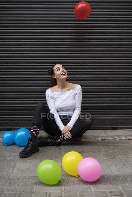 Woman watching flying balloon — Stock Photo