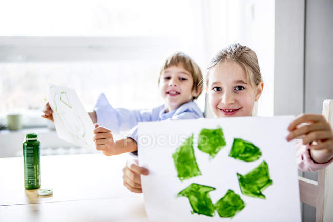 Girl and boy holding papers — Stock Photo