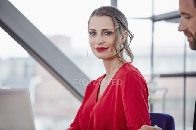 Smiling woman standing in office — Stock Photo