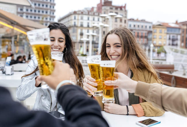Friends toasting with beer — Stock Photo
