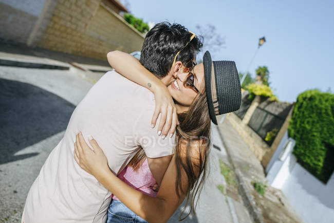 Couple embracing on the street — Stock Photo