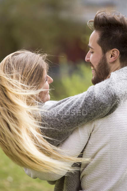 Man carrying girlfriend — Stock Photo
