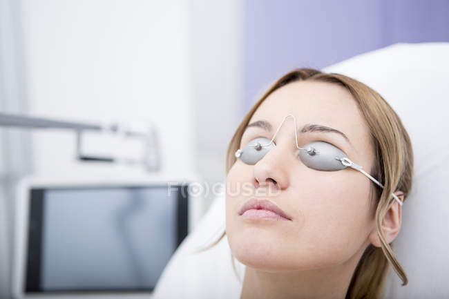 Woman wearing safety goggles — Stock Photo
