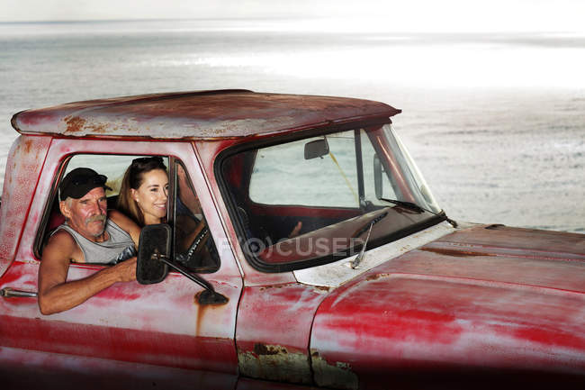 Man and young couple in pick up — Stock Photo