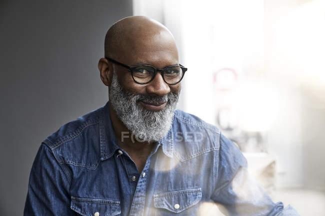 Smiling mature man looking at camera — Stock Photo