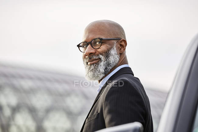 Businessman in spectacles looking at camera — Stock Photo