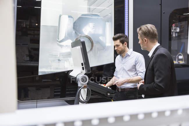 Men using control machine — Stock Photo