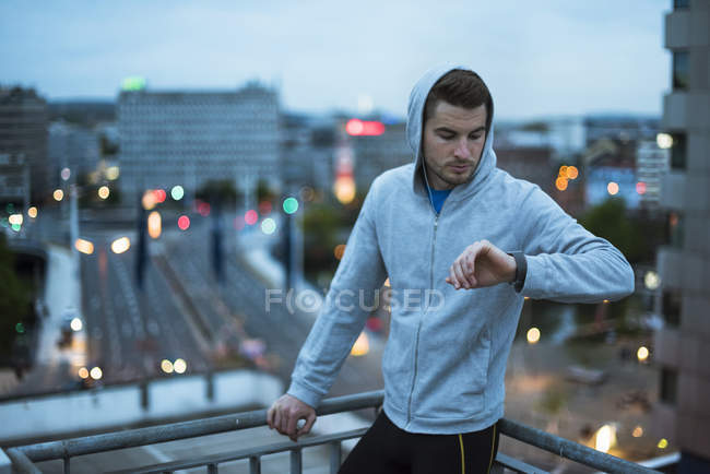 Athlete checking smartwatch — Stock Photo