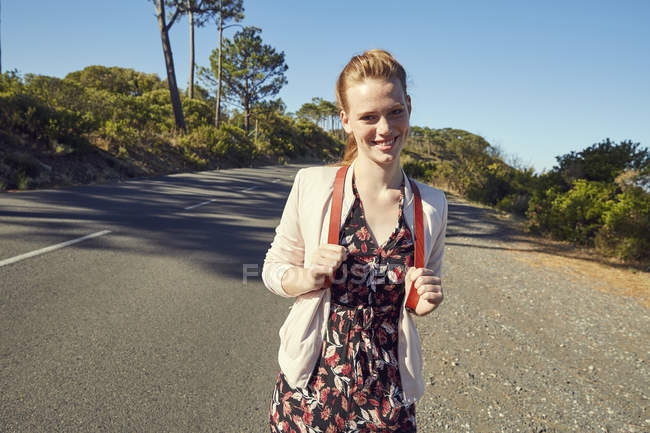 Young woman on country road — Stock Photo