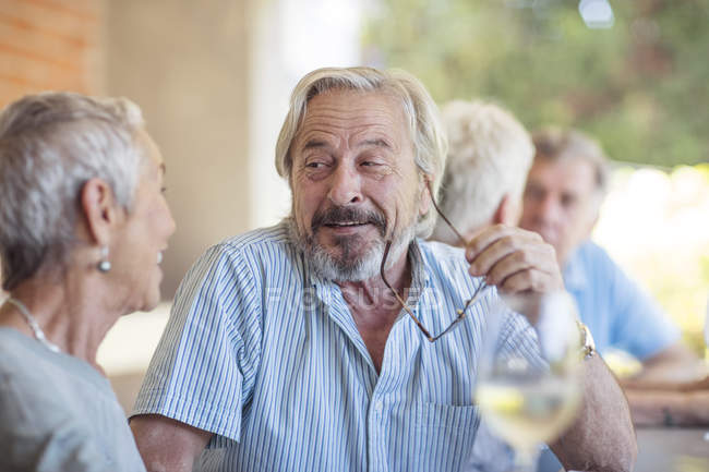 Senior man listening senior woman — Stock Photo