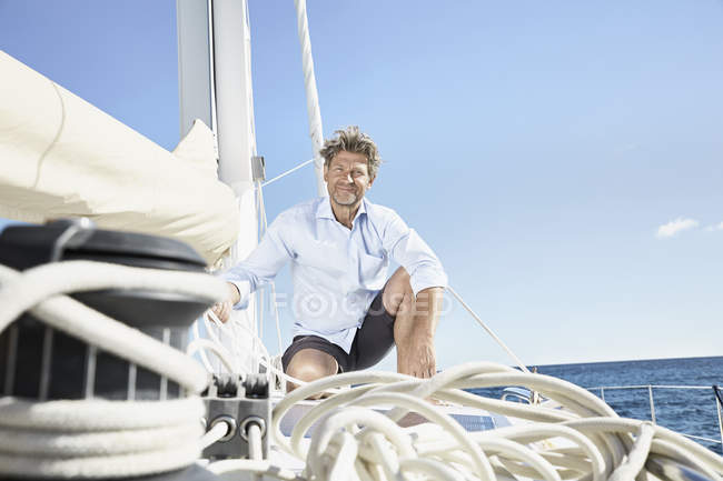 Man working with ropes on boat — Stock Photo