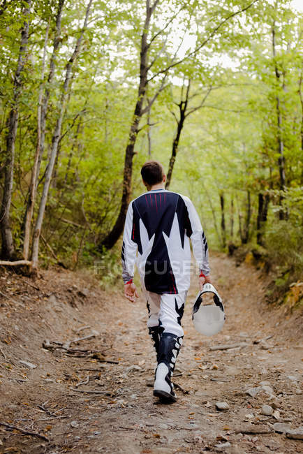 Biker walking on forest path — Stock Photo