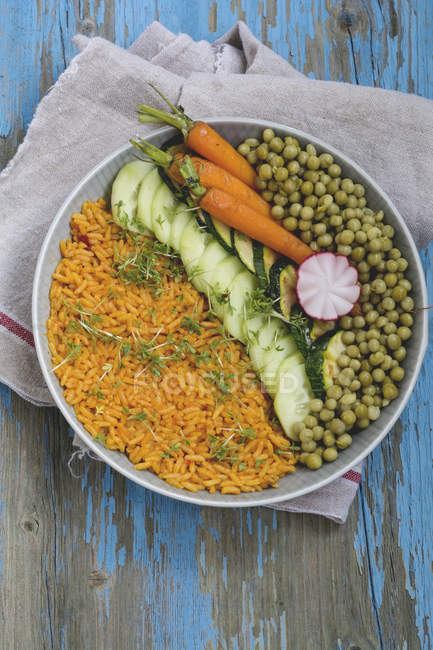 Bowl of rice with vegetables — Stock Photo