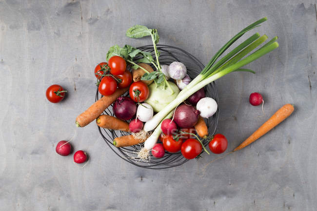 Wire basket with different vegetables — Stock Photo