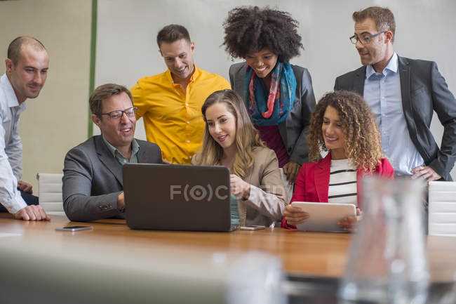 Colleagues sharing laptop — Stock Photo
