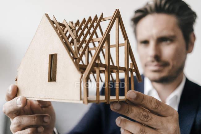 Architect examining model — Stock Photo