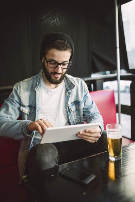 Man sitting using digital tablet — Stock Photo