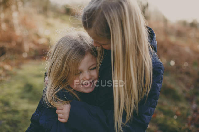 Two cute blond sisters — Stock Photo