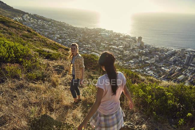 Women hiking above city — Stock Photo