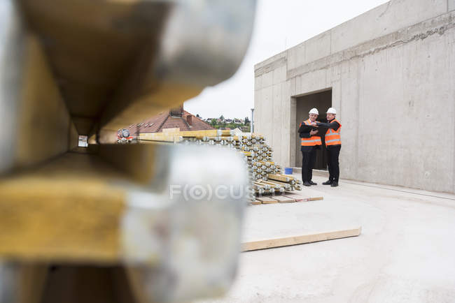 Men interacting on construction site — Stock Photo