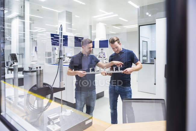 Two men in testing instrument room — Stock Photo