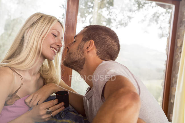 Couple waking up in bed — Stock Photo