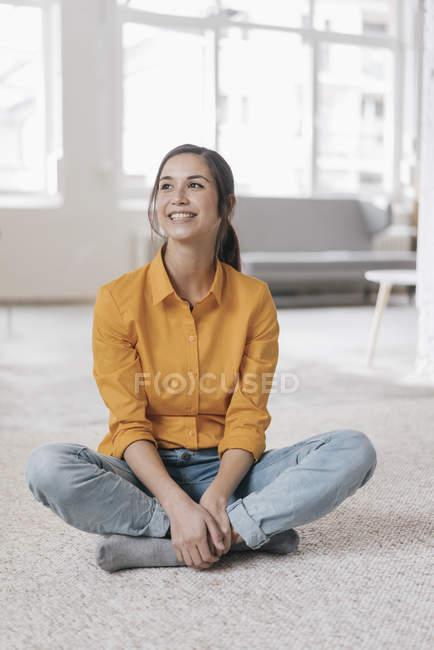 Woman sitting on floor — Stock Photo