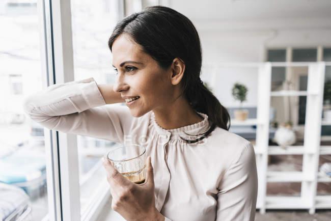 Woman holding glass — Stock Photo
